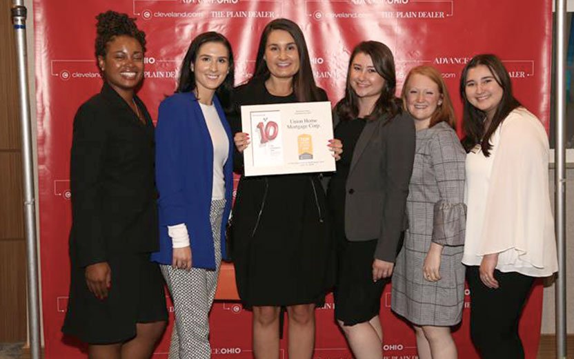 Advance Ohio Top Workplace 2020 group of employees with an award